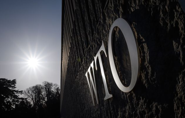 The logo of the World Trade Organization (WTO) is seen at the trade intergovernmental organization headquarters...