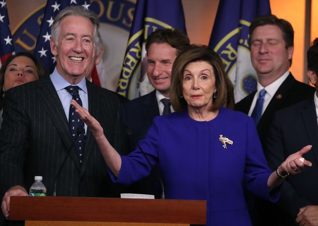 U.S. House Speaker Nancy Pelosi, centre, gestures during a news conference in Washington, D.C., where...
