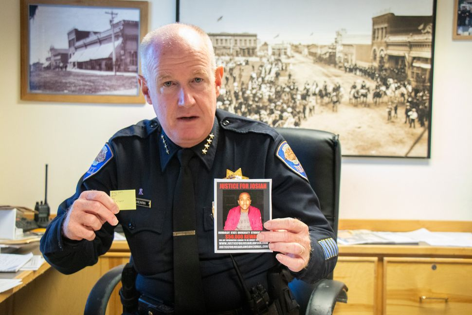 Arcata, California, Police Chief Brian Ahearn holds up a photo of slain student David Josiah Lawson and a note showing how ma