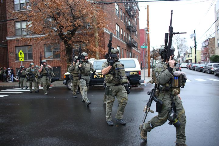 Police officers arrive at the scene of an active shooting in Jersey City, New Jersey, on Dec. 10.