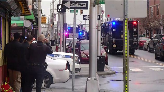 In this image taken from video, police officers respond at the scene following reports of gunfire on