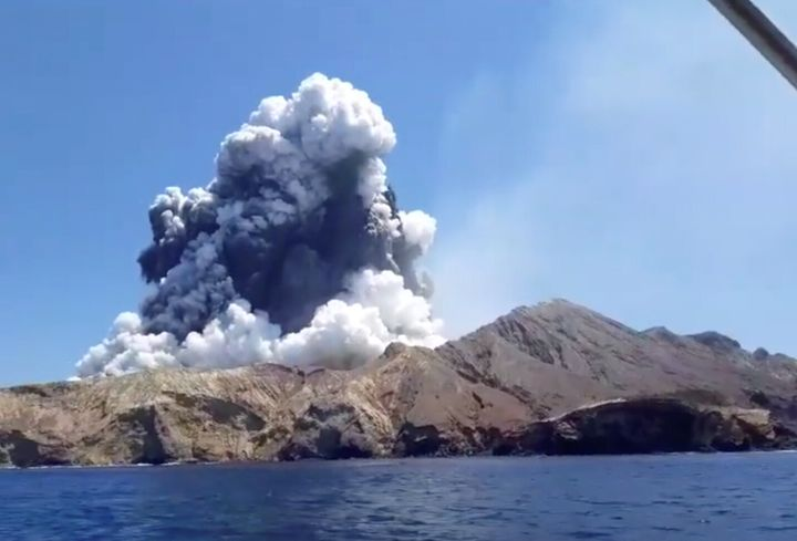Smoke from the volcanic eruption of Whakaari, also known as White Island, is pictured from a boat, New Zealand December 9, 2019 in this picture grab obtained from a social media video. INSTAGRAM @ALLESSANDROKAUFFMANN/via REUTERS
