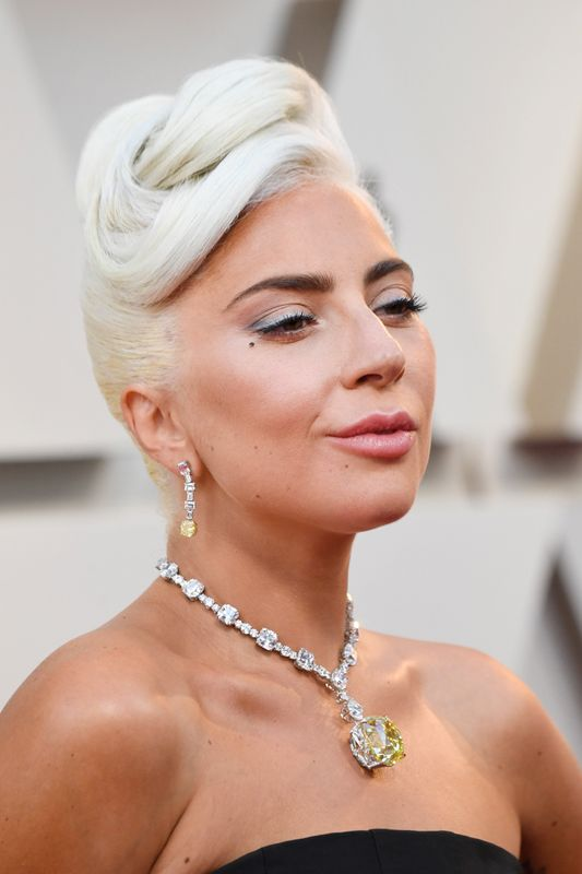 Lady Gaga at the Oscars in Los Angeles on Feb. 24. Makeup by Sarah Nicole Tanno. Hair by Frederic Aspiras.