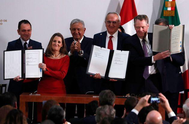 Mexico's Treasury Secretary Arturo Herrera, left, Deputy Prime Ministe Chrystia Freeland, second left,...