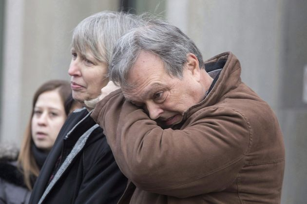 Clayton Babcock, right, stands next to his wife Linda outside court in Toronto on Dec. 16,