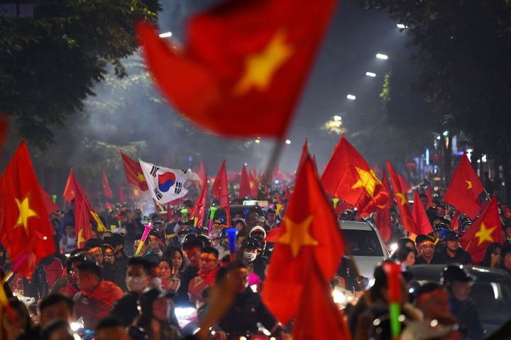 December 10, 2019 shows Vietnamese fans celebrating on the streets in Hanoi following Vietnam's victory over Indonesia in the men's football final match at the SEA Games (Southeast Asian Games).