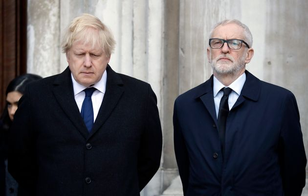 Britain's Prime Minister Boris Johnson, left, and Labour Party leader Jeremy Corbyn take part in a vigil...