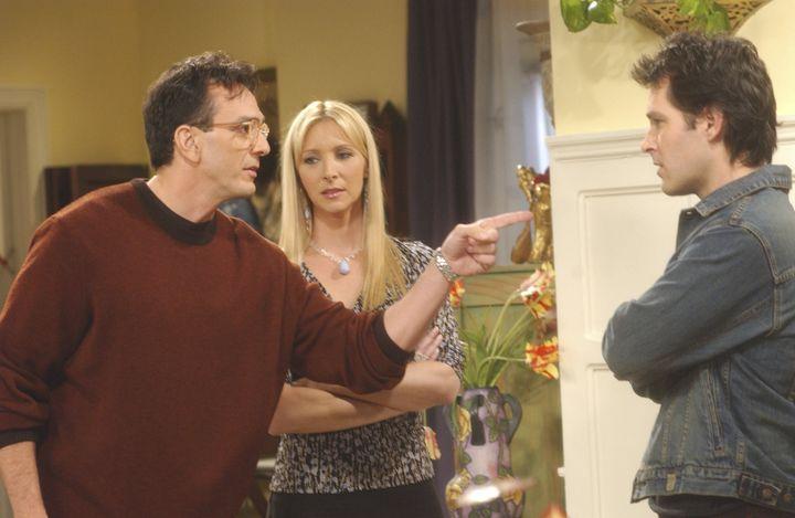 Phoebe Buffay (Lisa Kudrow, center) eventually chose Mike Hannigan (Paul Ruff, right) over David (Hank Azaria, left) in Friends.