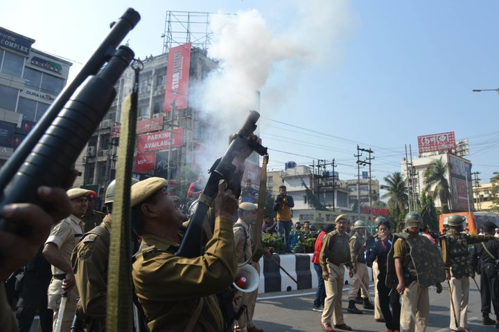 Police personnel fire tear gas to disperse the students protesting against the government's Citizenship Amendment Bill (CAB), in Guwahati on December 11, 2019.