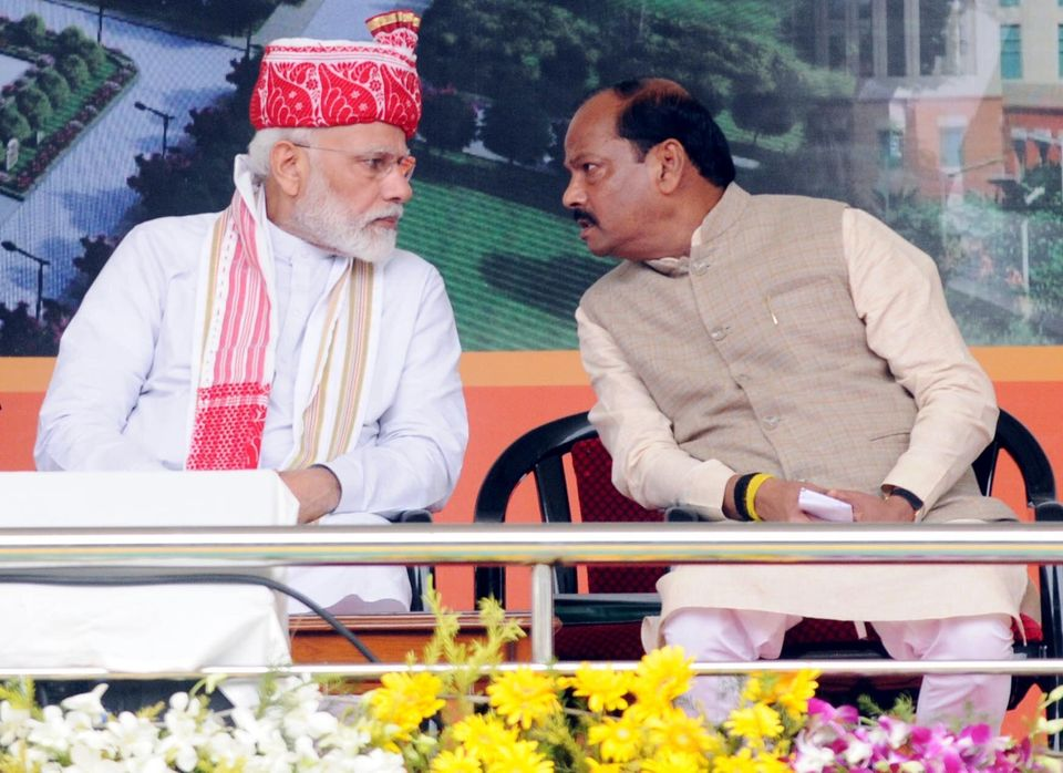 Prime Minister Narendra Modi in conversation with Chief Minister Raghubar Das in a file