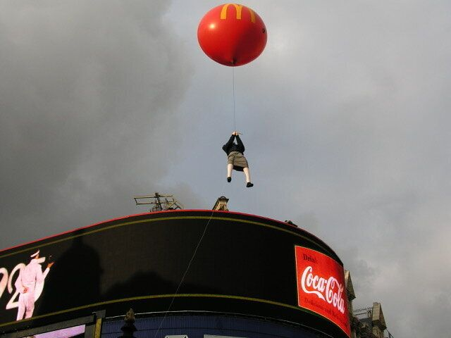 Banksy's floating girl was later struck by a bus.