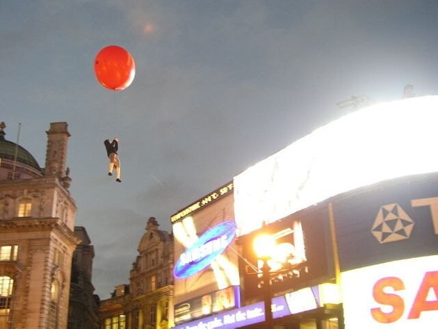 Banksy transformed a helium-filled sex doll into a child being carried into the sky by a gigantic McDonald's-branded...