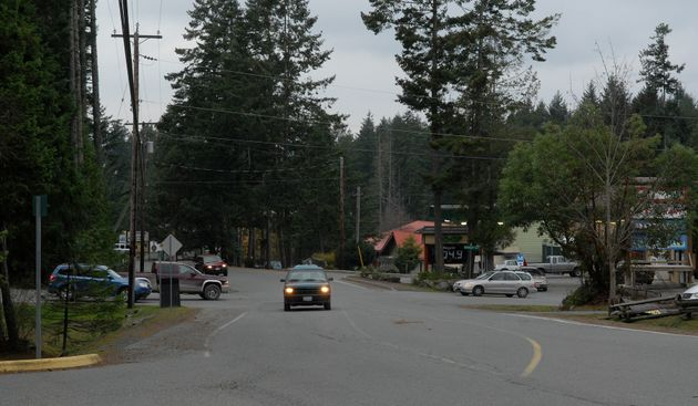 Cars are seen travelling along North Road on Gabriola Island, B.C., in this undated