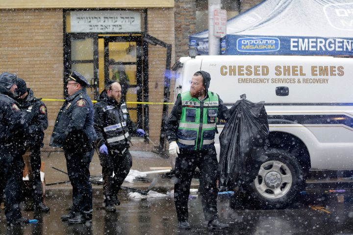 Emergency responders work Wednesday near a kosher supermarket and a synagogue near the site of a shooting in Jersey City, New