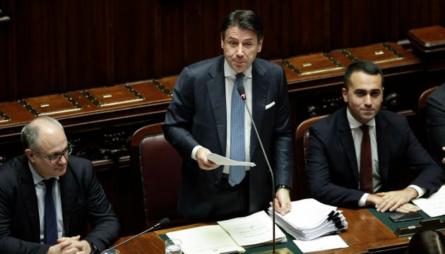 Italian Premier Giuseppe Conte, center, flanked by Economy Minister Roberto Gualtieri, left, and Foreign...