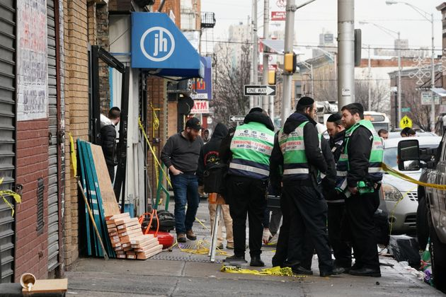 A crew works at the scene of Tuesday's shooting at a Jewish deli in Jersey City, New