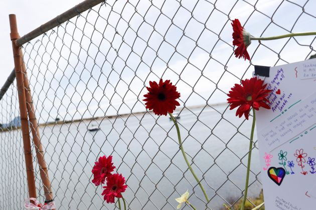 Flowers are seen at a memorial at the harbour in Whakatane, following the White Island volcano eruption...