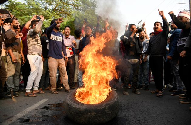 Demonstrators burn tyres during a strike called by All Assam Students Union (AASU) and the North East...