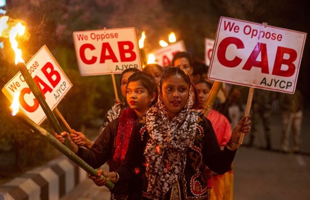 Indians participate in a torch light procession to protest against the Citizenship Amendment Bill (CAB)...