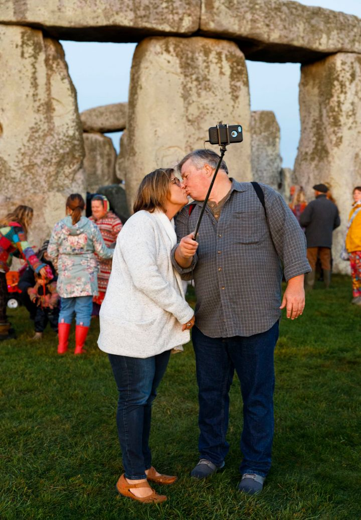 This is the newest image in the exhibition, an unknown couple kissing while taking a selfie against the backdrop of the stones during the 2019 Autumn Equinox