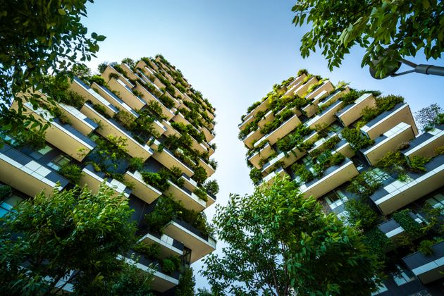 Milan, Italy, High-rise house with trees, shrubs and hedges in the city of