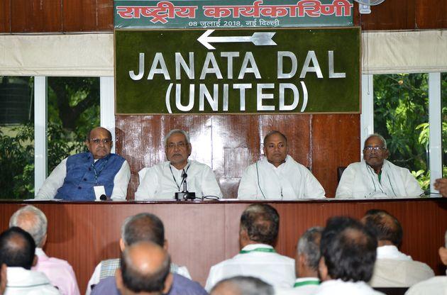 Bihar Chief Minister and JDU Chief Nitish Kumar (second from left), General Secretary K. C. Tyagi (left)...