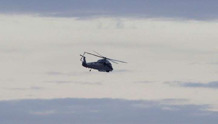 A New Zealand Navy helicopter takes off from Whakatane Airport as the mission to return victims of the White Island eruption