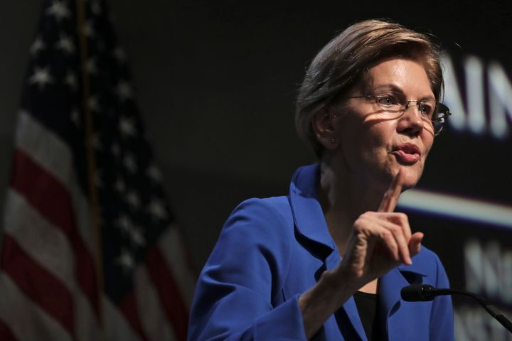 Democratic presidential candidate Sen. Elizabeth Warren, D-Mass., gestures during her address at the New Hampshire Institute