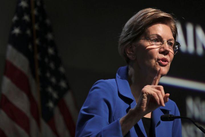 Democratic presidential candidate Sen. Elizabeth Warren, D-Mass., gestures during her address at the New Hampshire Institute