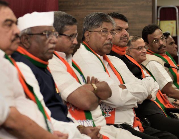 Maharashtra BJP President Chandrakant Patil and Former Maharashtra Chief Minister Devendra Fadnavis with...