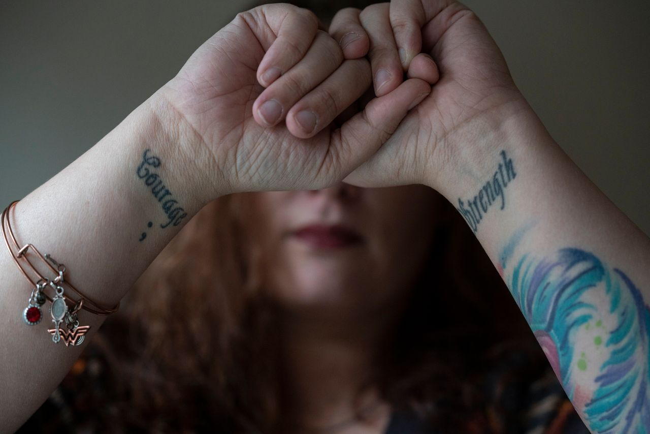 """Before leaving her ex-husband she got tattoos on her wrists with the words """"Strength"""" and """"Courage"""" to remind herself, she said, that she had both inside of her."""