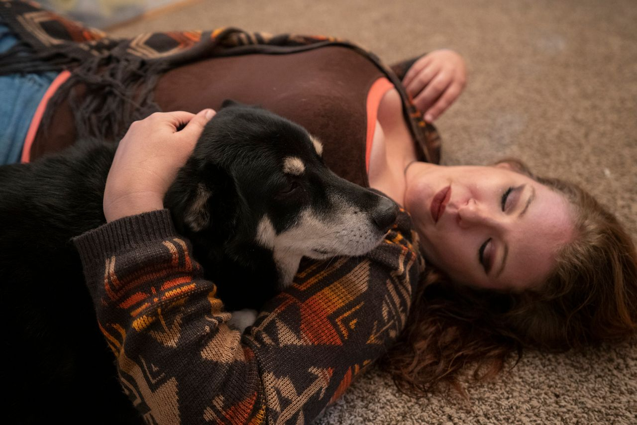 Tamara Campbell says that her dog, Bandit, is her protector. She said once, when her ex-husband had cocked his arm back to hit her, Bandit lunged and sank his teeth into his arm. Unfortunately, Campbell says, the abuse was then redirected at the dog, who was viciously beaten. (Melissa Lyttle for HuffPost)