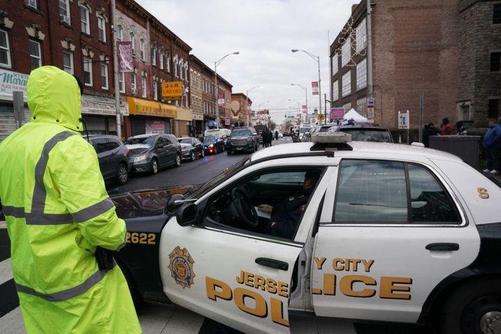 Jersey City police gather at the scene of Tuesday's shooting in Jersey City, New Jersey.