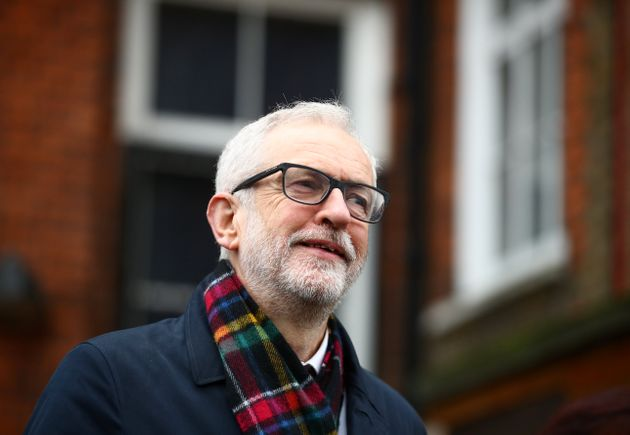 Britain's opposition Labour Party leader Jeremy Corbyn poses outside a polling station after voting in...
