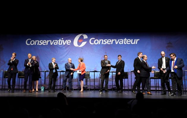 Conservative leadership candidates shake hands following the Tory leadership debate in Toronto on April...