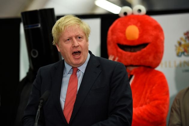 Britain's Prime Minister and Conservative leader Boris Johnson gives a speech on stage after retaining...