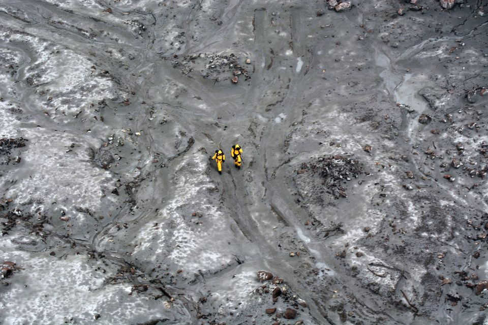 Experts pictured during the recovery operation at Whakaari/White Island on December