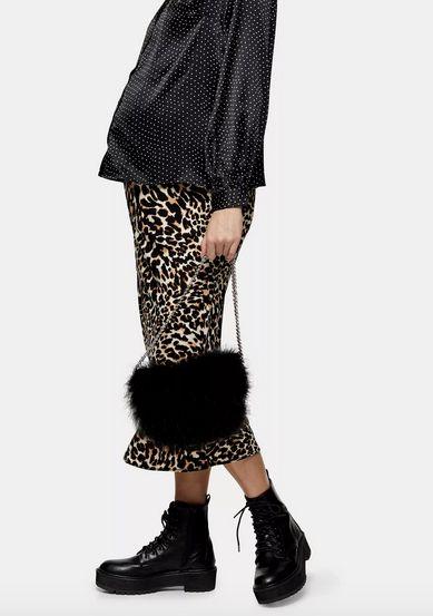 "<a href=""https://fave.co/2tezBH6"">Leopard print bias skirt, Tophshop</a>, &pound;35"