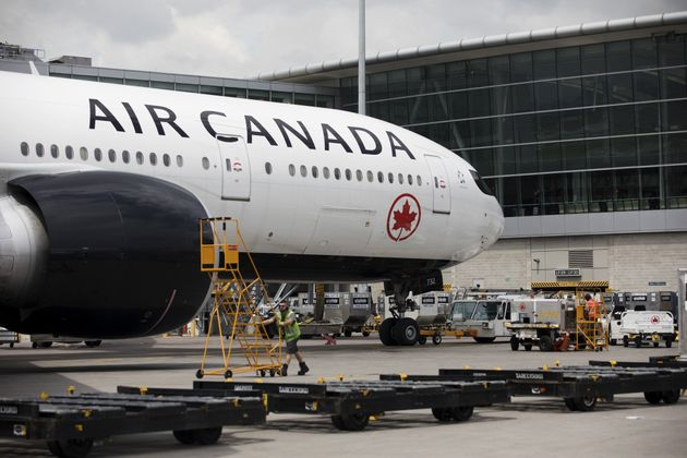 An Air Canada plane sits parked at Toronto Pearson International Airport on July 22, 2019. Air Canada...