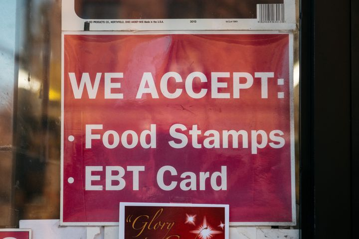 A sign alerting customers about SNAP food stamps benefits is displayed at a Brooklyn grocery store in New York City.