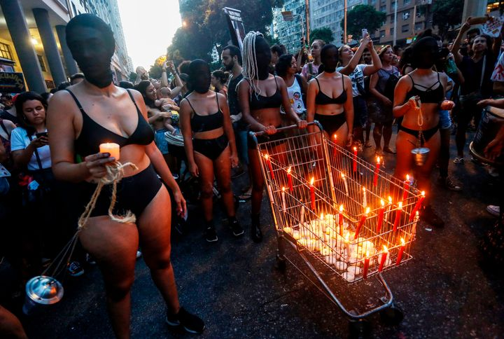 Women take part in a demonstration to mark International Women's Day in Rio de Janeiro, on March 8, 2019.