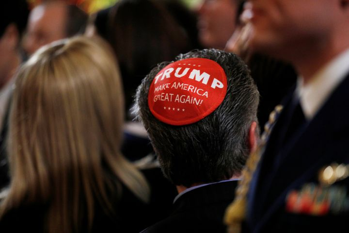 "A participant wears a Trump ""Make America Great Again"" yarmulke at a White House Hanukkah reception where U.S. President Dona"