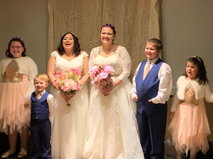 The brides and their four kids. Look at those smiles!