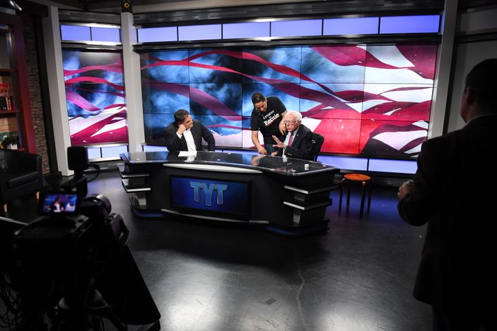 Sen. Bernie Sanders prepares for an interview with Cenk Uygur, left, at the Young Turks studios in Culver City, California, d