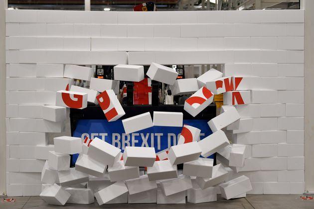 Boris Johnson drives a Union flag-themed JCB, with the words