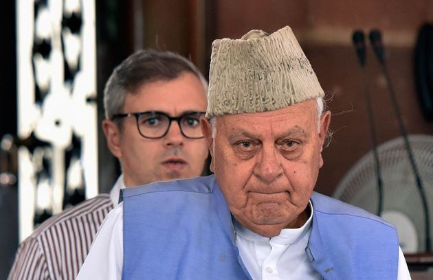 National Conference's Farooq Abdullah and his son Omar Abdullah at Parliament House, on June 25, 2019...