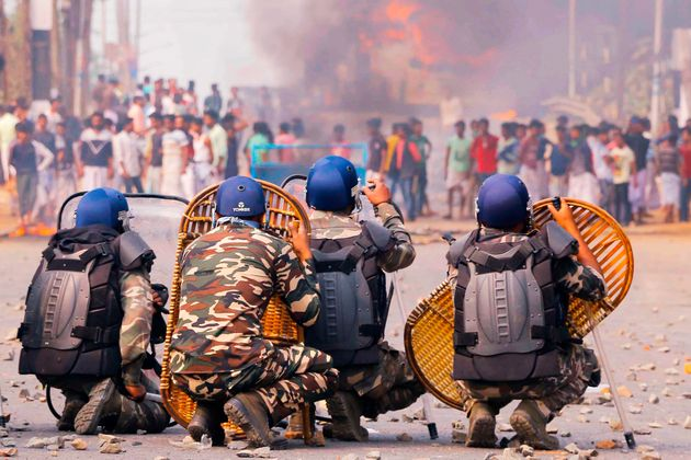 Protesters clash with police on a road during a demonstration against Citizenship Act in