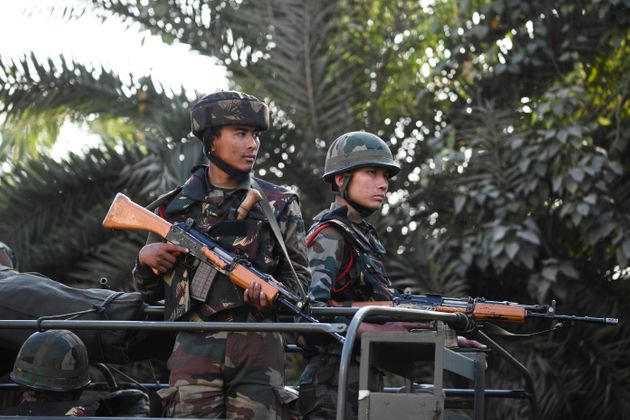 Soldiers guard a street in Guwahati on December 13,