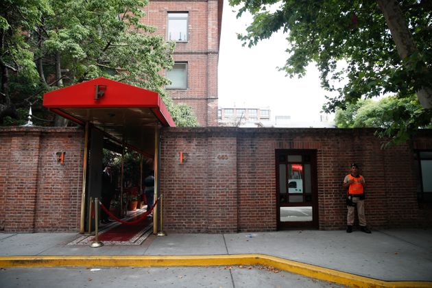 A naval official guards the entrance of the Faena Art Hotel in Buenos Aires, Argentina, hours after assailants trying to rob two British tourists shot and killed one of them and wounded the other, Saturday, Dec. 14, 2019 (AP Photo/Natacha Pisarenko)