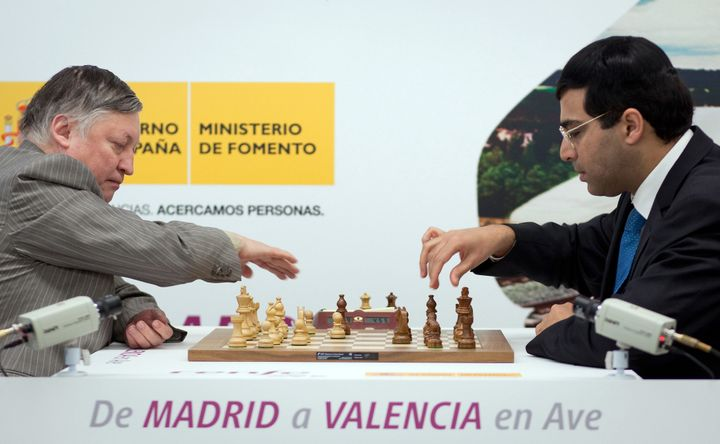 Former world chess champion Anatoly Karpov, left, and world chess champion Vishwanathan Anand are seen during an exhibition match in the Atocha railway station in Madrid on Tuesday Feb. 1, 2011.